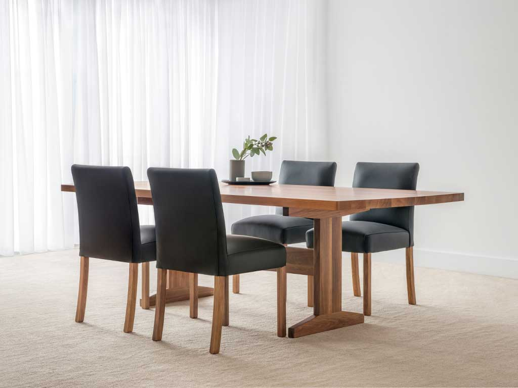 thin timber dining table with modern black leather chairs with square legs