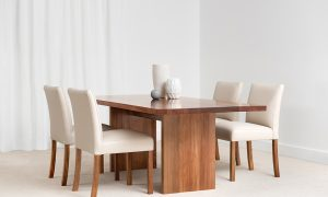 thin dining table with inner side panels and upholstered chalk leather chairs