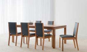 brown timber rectangular table with 4 thick legs and triangular shaped chairs with upholstered seat and back and timber framing