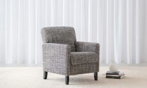 supportive textured fabric armchair with black timber leg and think arms
