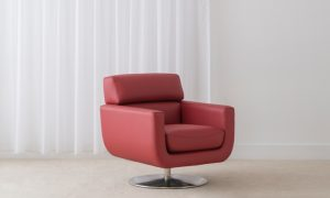 modern red leather swivel chair on circular chrome base and low back