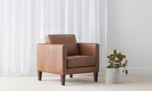 contemporary brown natural leather armchair on tapered wooden leg with narrow arms