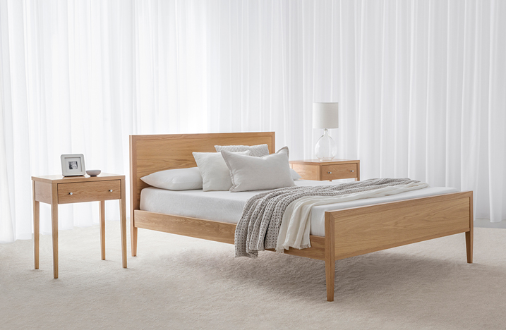 contemporary thin american oak timber bed with headboard and bed end and matching bedside tables on thin legs with square edges