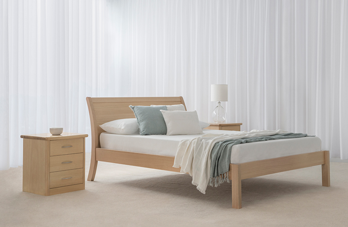mountain ash timber bed with backward curved headboard and square end legs with square 3 drawer bedside cabinet