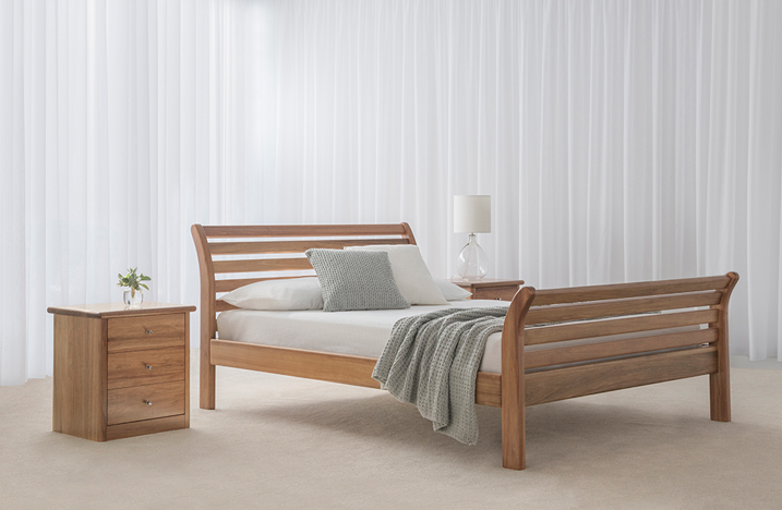 blackwood bed with timber slats on headboard and bed end plus curved angles and square 3 drawer bedside cabinets