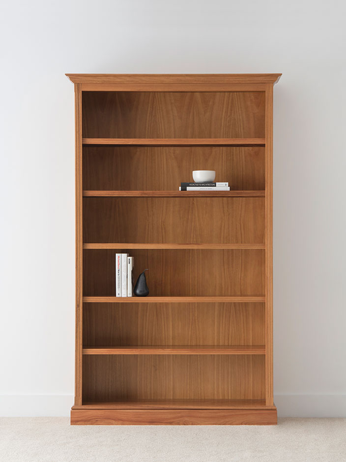 traditional bookcase in solid timber with 5 shelves and flared capping with traditional groove detailing