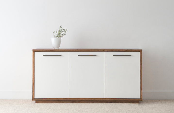 white buffet with timber feature and full base with long silver handles