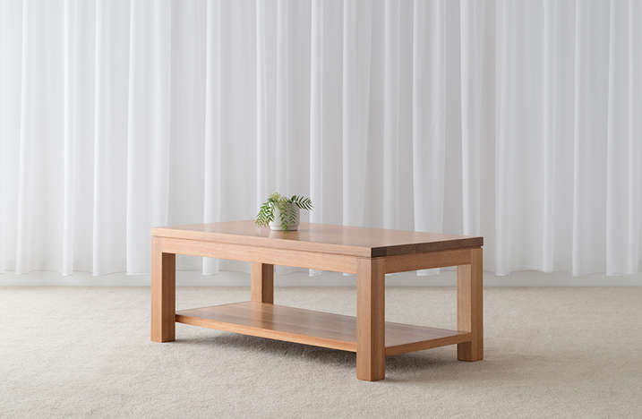 simple classic design narrow rectangle coffee table with bottom shelf and 4 square legs in light tasmanian blackwood