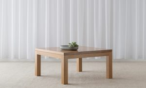 simple square coffee table in light timber with thick square legs