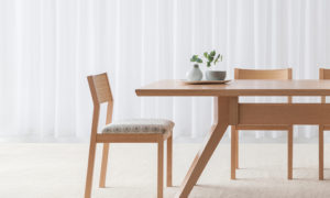 curved timber back chair with upholstered fabric seat with open space and slim legs