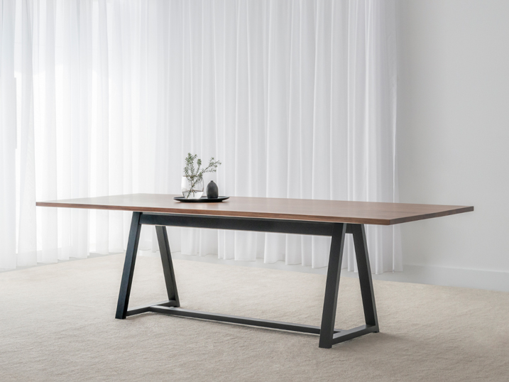 thin blackwood timber top with black triangular leg frame