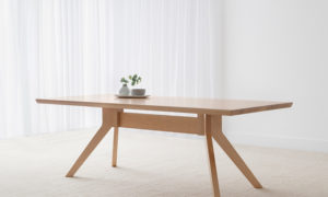 Scandinavian style mountain ash timber table with bevelled edge and angled legs