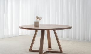round solid timber dining table with triangle trestle legs in satin finish