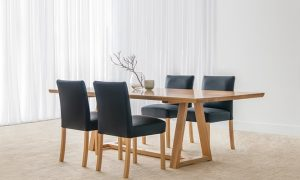 8 seater dining suite with upholstered black leather chairs and mountain ash table with slim top, trestle leg and foot runner