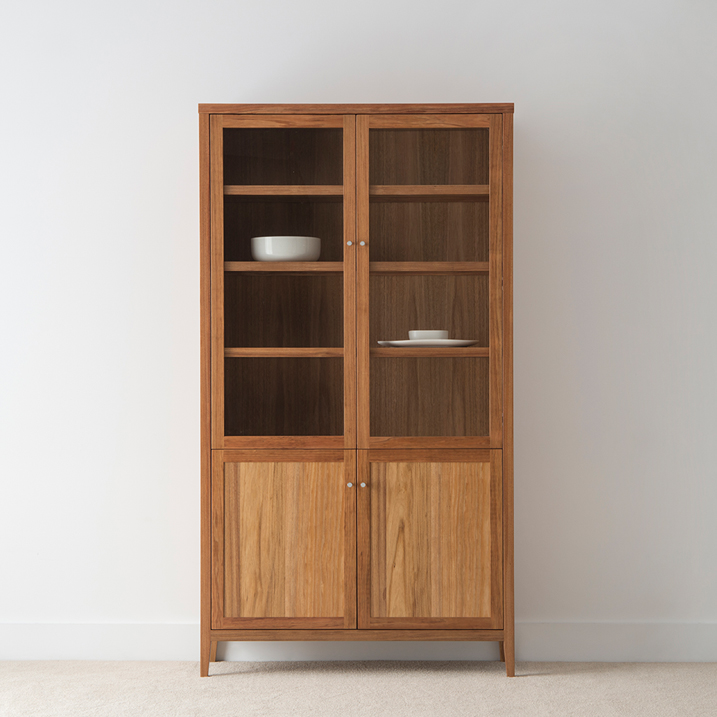 tall display cabinet with glass doors and timber doors on a tapered leg in tasmanian blackwood plus adjustable shelves
