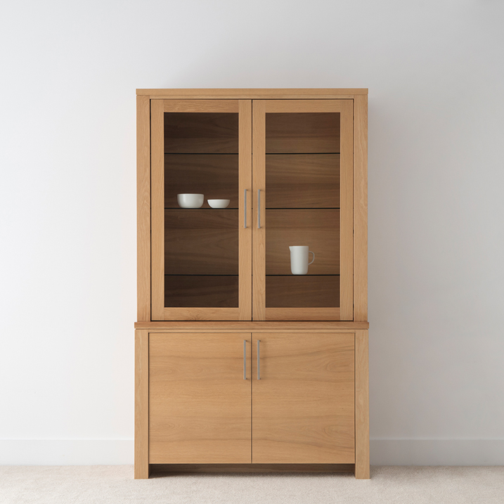 solid american oak timber display unit with glass front and timber doors, glass shelves and long silver handles