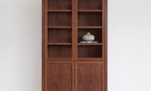 jarrah display cabinet with adjustable shelves and glass doors, on thin leg and solid timber doors