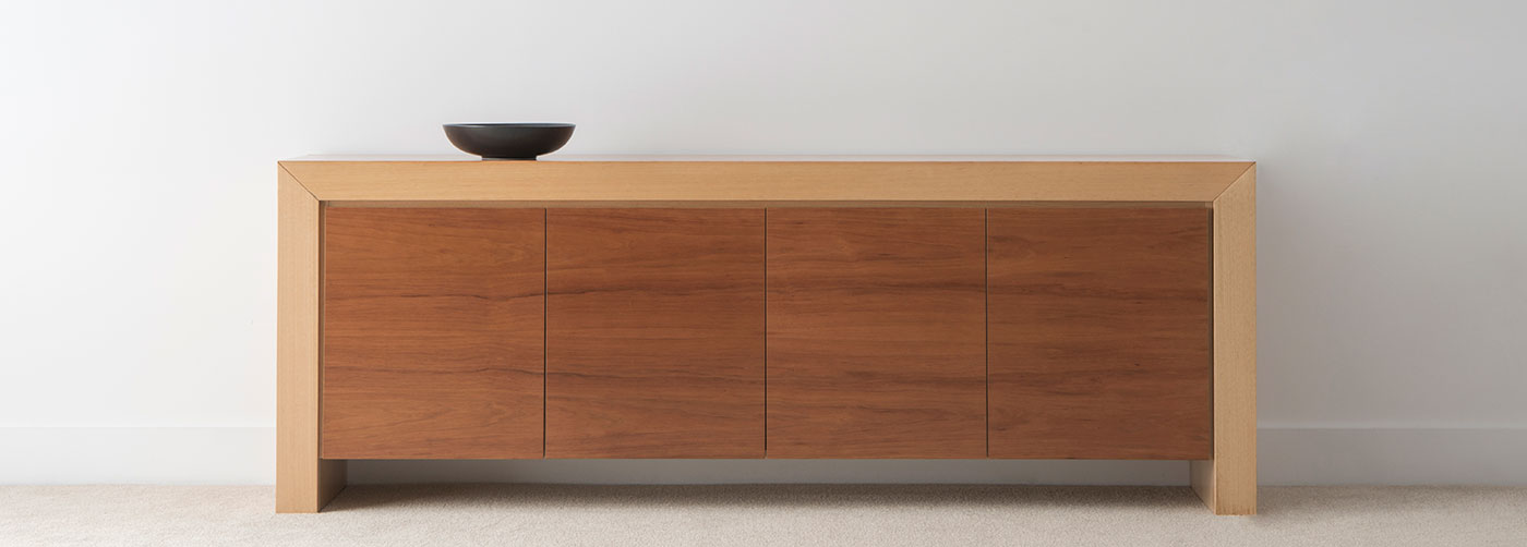 two tone sideboard with 4 flush doors and solid side panels