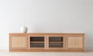 square light timber entertainment unit with 2 timber doors and 2 glass doors and internal shelving, with silver handles
