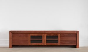 jarrah entertainment unit with 2 glass doors and 2 solid timber doors on thick leg