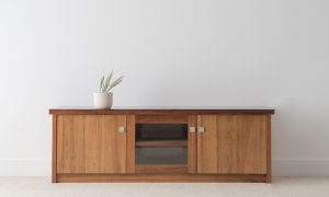 solid timber cabinet with slight overhang and square silver handles