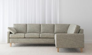 modular lounge textured khaki fabric with narrow arm rest and accessory cushions sitting on light timber leg
