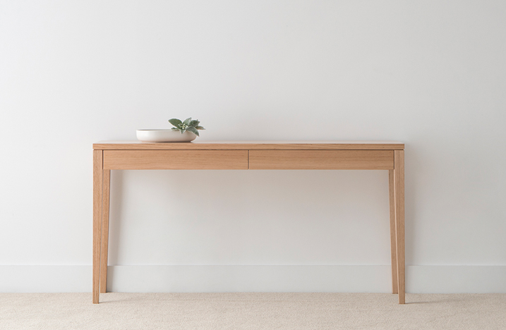 modern simplistic light timber hall table with 2 front drawers and slim tapered legs