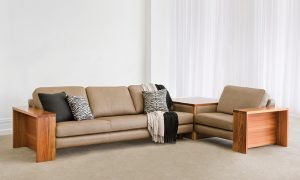 brown leather modular with timber arms and attached timber corner table