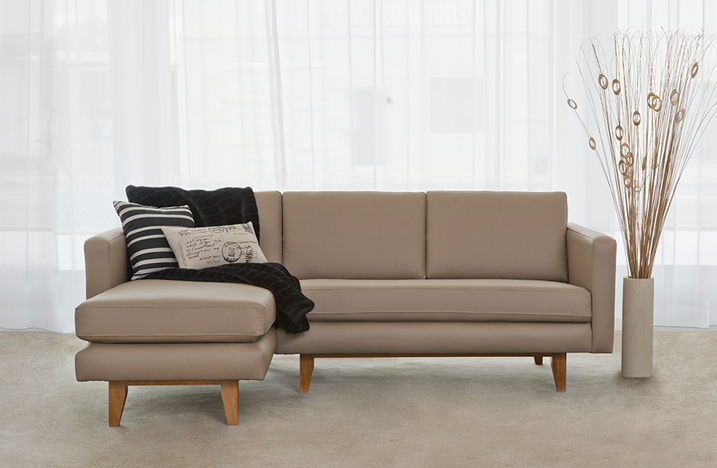 compact modular in taupe leather with timber base and narrow arms
