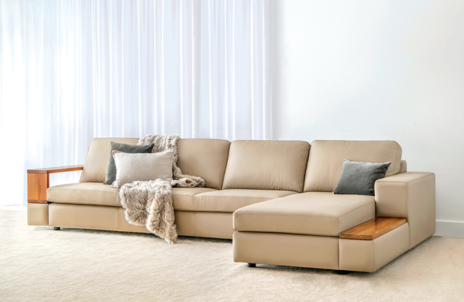 cream leather modular with timber arm and low timber shelf, wide arm and chaise with relaxed cushions