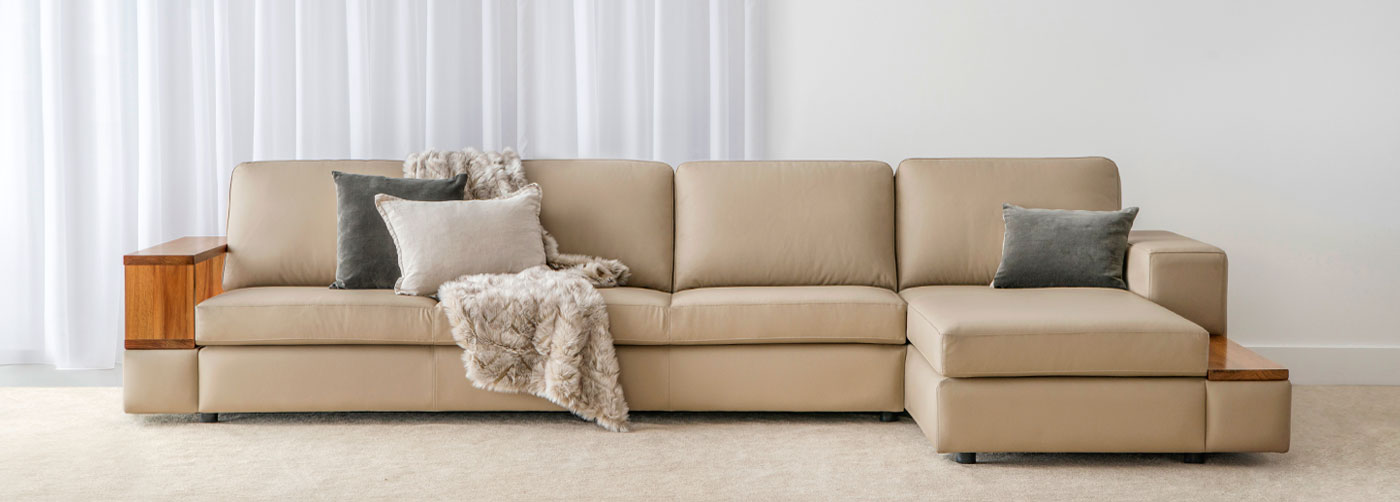 luxurious comfortable leather modular lounge with blackwood timber arm features and return chaise