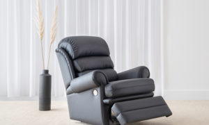 traditional recliner chair with rolled arm feature in classic black leather