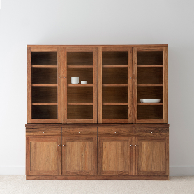 large solid timber wall unit with glass doors and timber drawers and doors, adjustable shelves and set back top