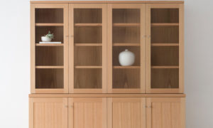 large contemporary wall unit in mountain ash with glass doors and solid timber base doors with small silver chrome knobs