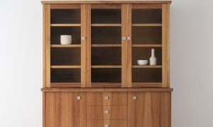 tasmanian blackwood wall unit with 3 glass display doors and 2 timber doors with timber drawers and square silver handles on a full base