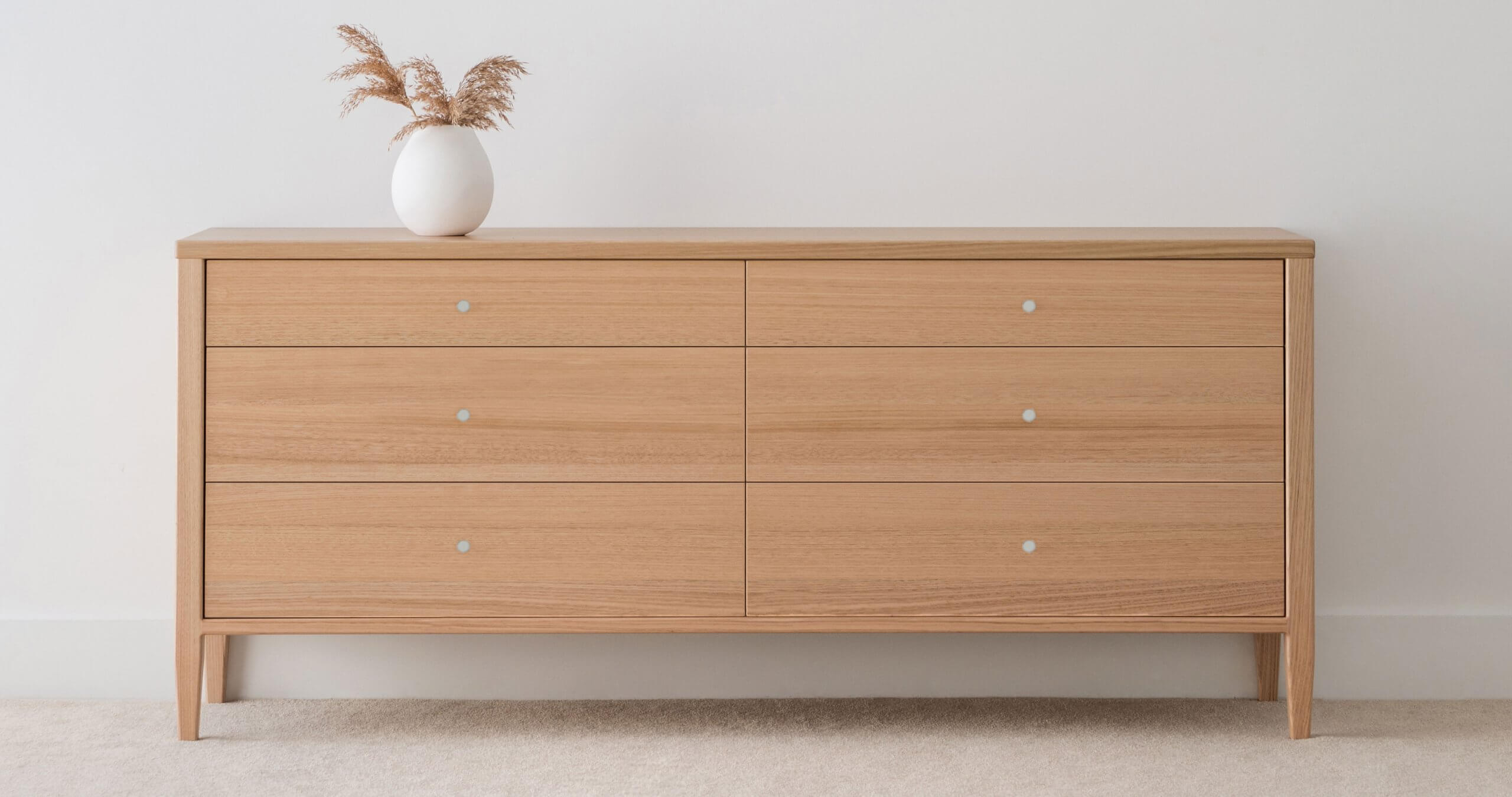 chest of drawers made in Adelaide from ash timber with tapered legs
