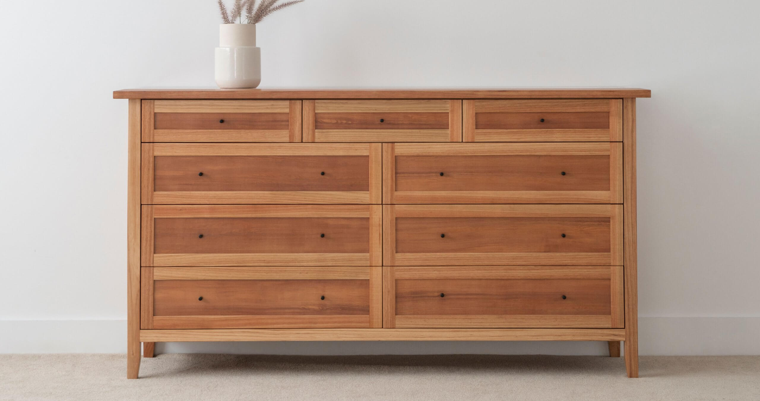 custom chest of drawers with overhang top and two tone timber