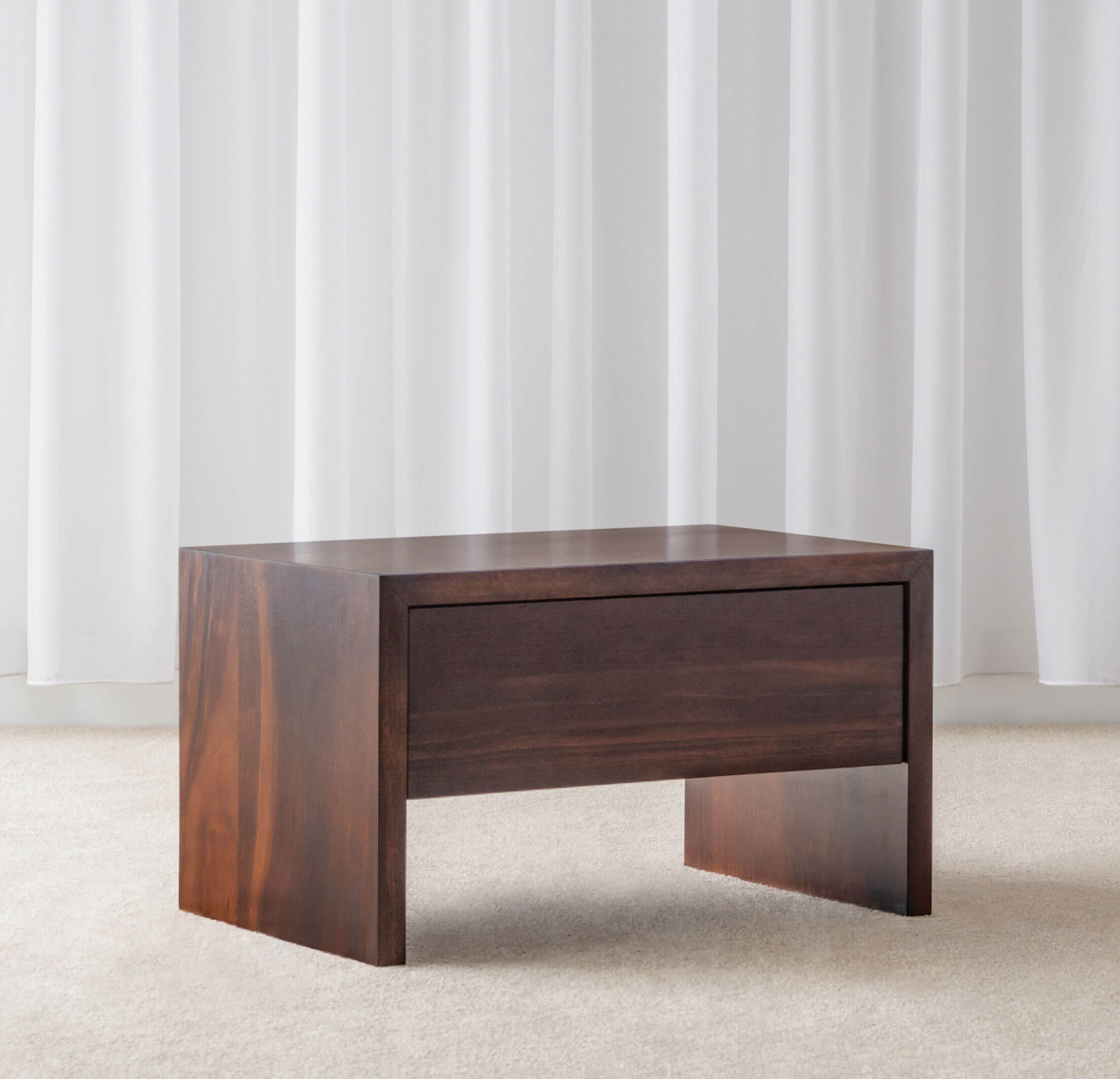 modern bedside table with side panels and push to open drawer