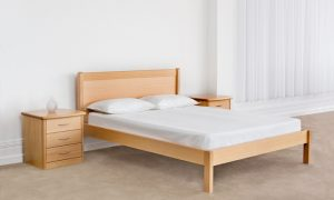 light timber bed frame with headboard and low end high off the ground with large 3 door bedside cabinets