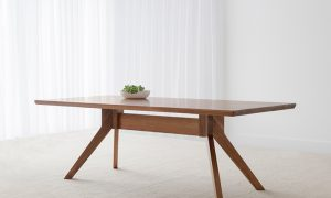 Scandinavian style tasmanian blackwood timber table with bevelled edge and angled legs
