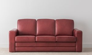 burgundy leather 3 seater 3 cushion lounge with high back and full base and wide arm