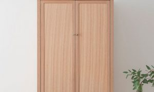 mountain ash stand alone wardrobe with two wide doors and chrome handles on a thin leg