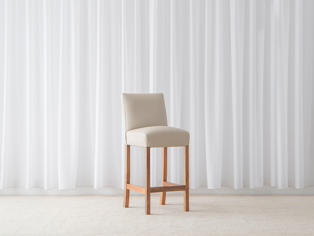 fully upholstered leather bar stool in cream colour with hardwood timber frame