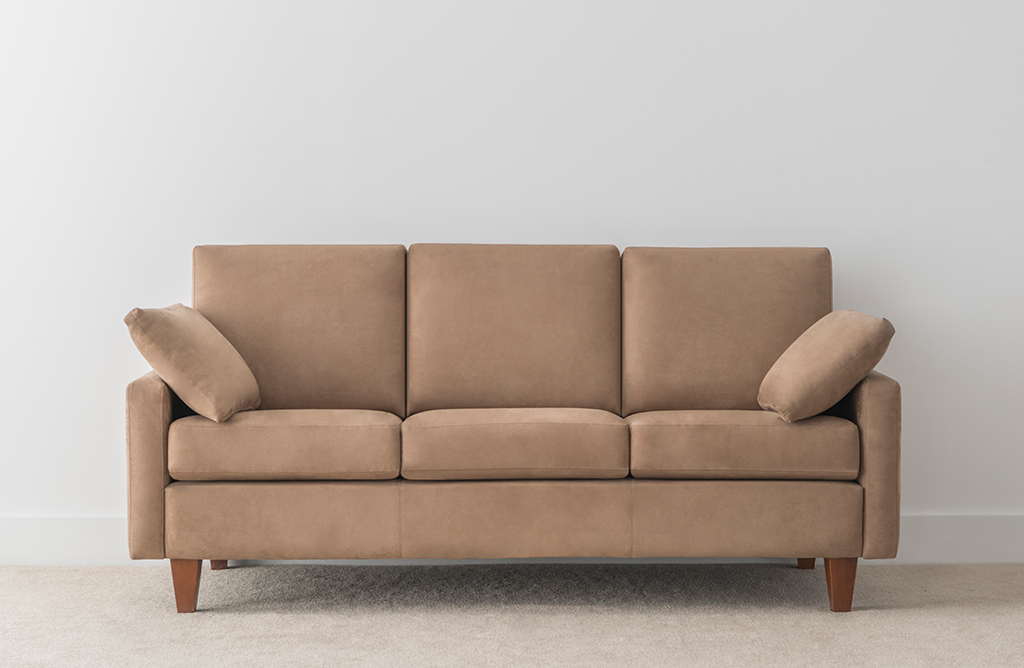 3 seater suede fabric sofa with arm cushions and timber leg
