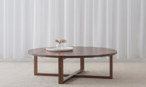large low round coffee table in tasmanian blackwood timber with cross leg base