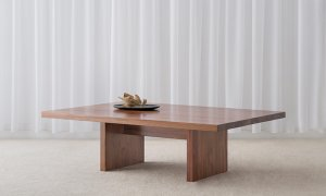 low modern rectangular coffee table with panel ends and large top in blackwood timber
