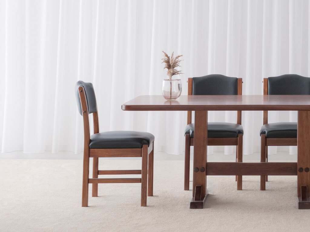 traditional dining chair with leather upholstered seat and back on chocolate timber frame with foot rails