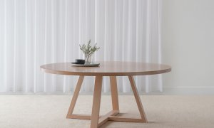 contemporary round dining table crafted in mountain ash timber with cross testle base