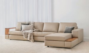 luxurious natural leather modular lounge with large cushions and timber arm features on solid full base