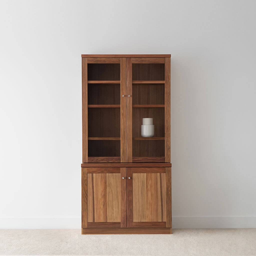 designer storage display cabinet in tasmanian blackwood timber with glass and timber doors and internal wooden shelves
